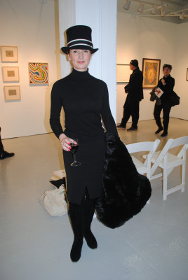 Lisa Carey, old enough, a milliner from New York, New York, wearing one of her creations.